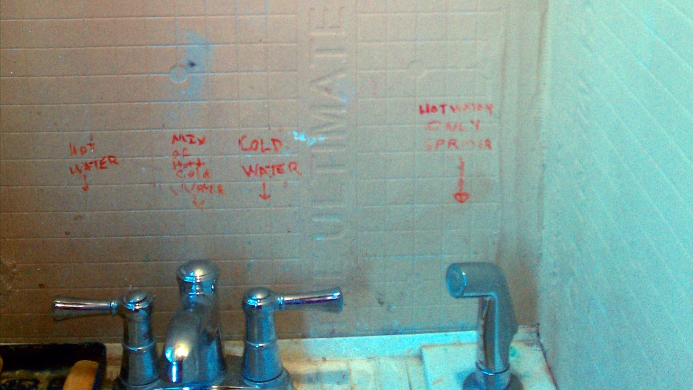 A bathroom before tiling is done, revealing the cement board base.