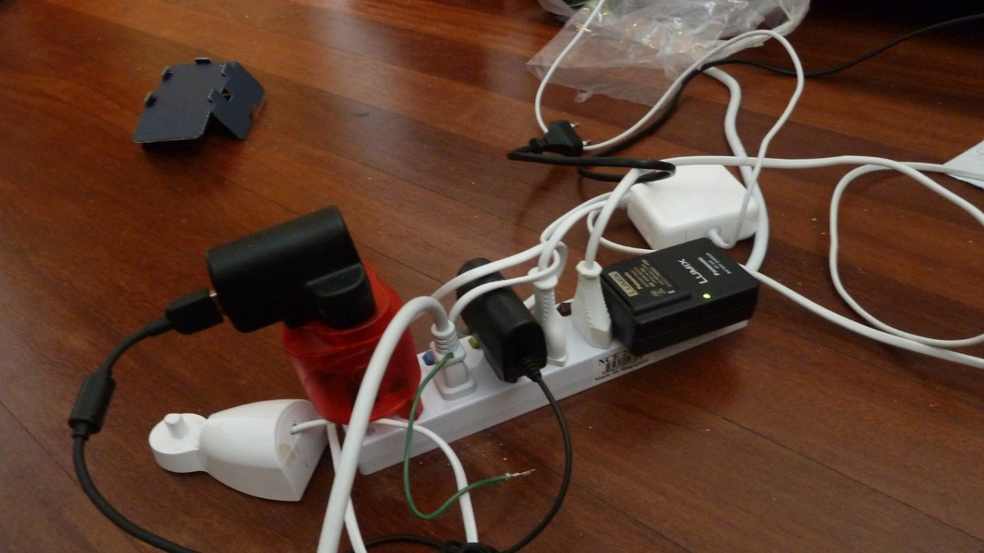 A power strip overloaded with too many plugs.