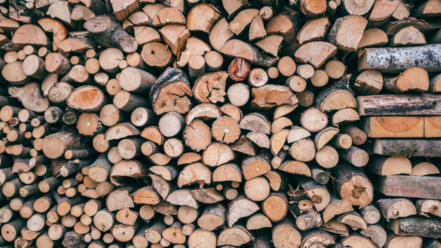 Large pile of stacked firewood.