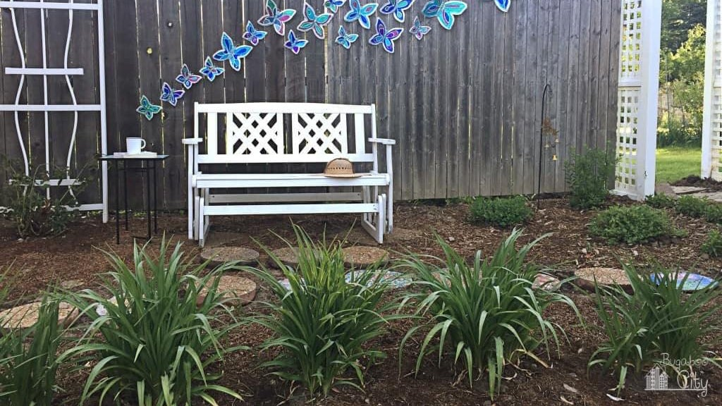 DIY butterfly fence decor