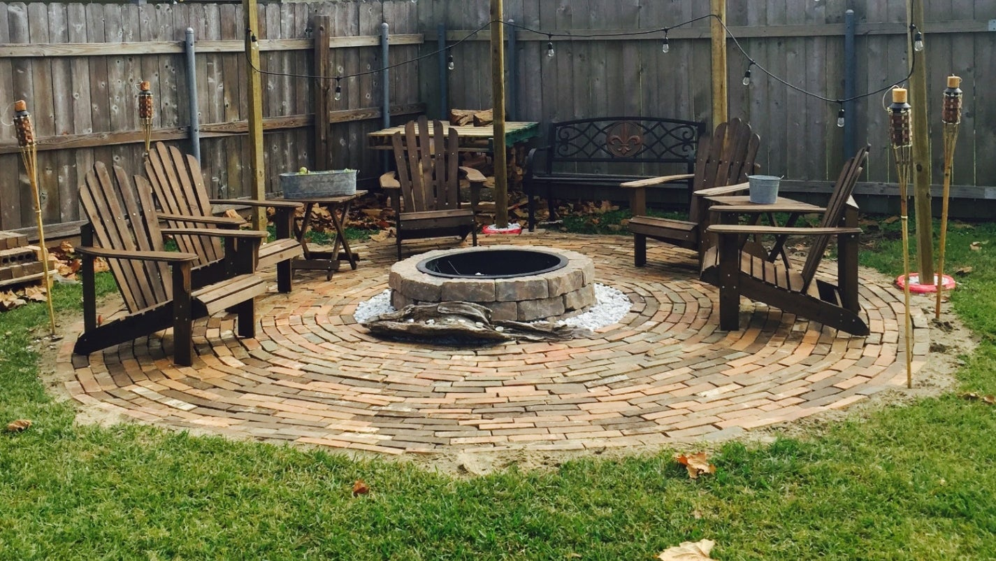 DIY fire pit area with string lights