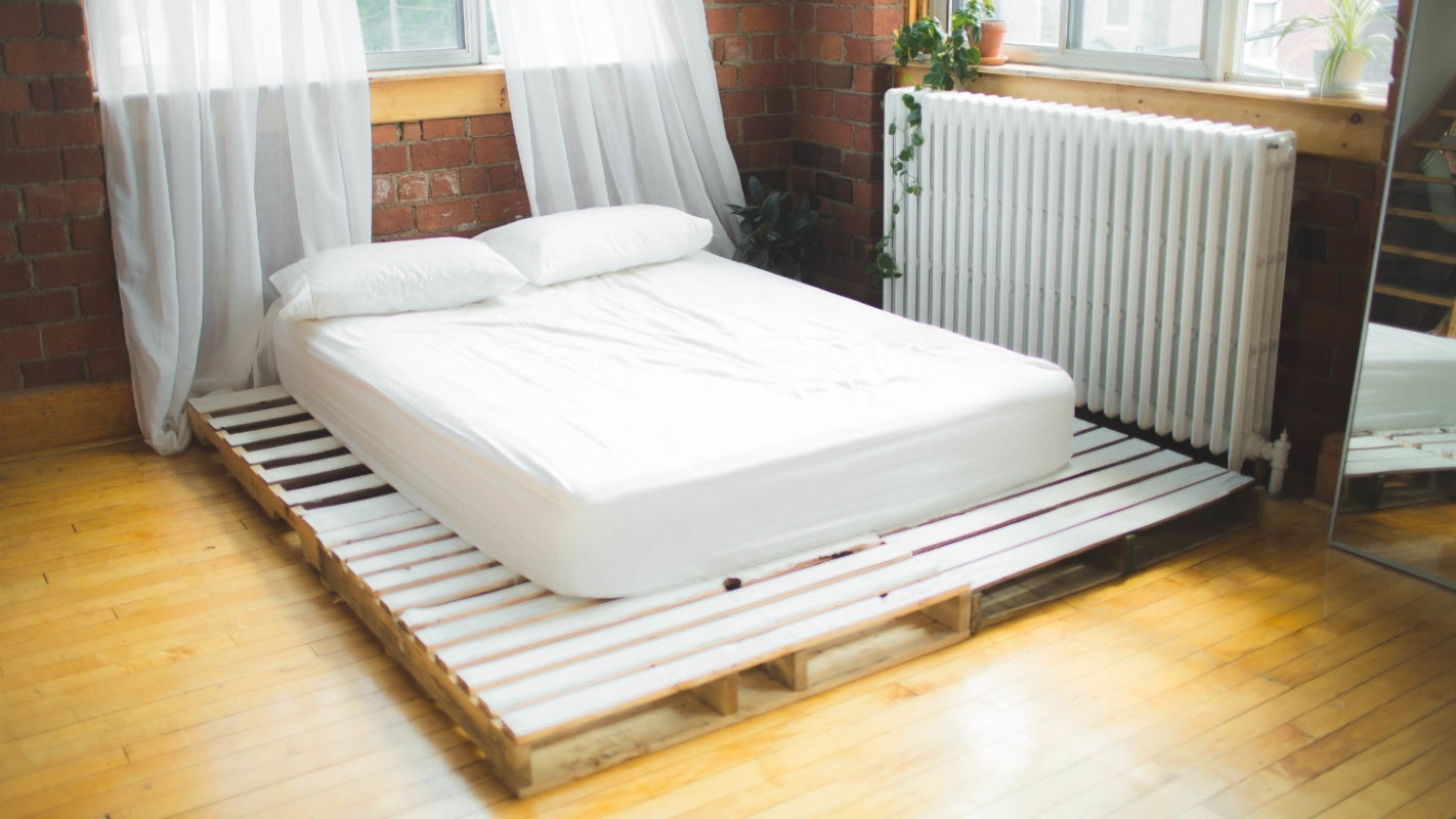 DIY pallet bed base with white mattress on top