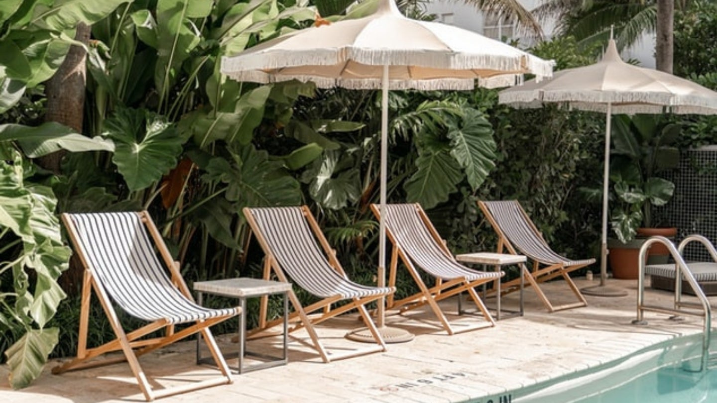 Sling beach chairs by a pool.