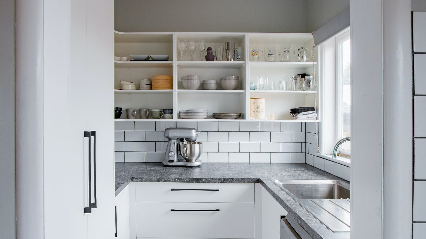 white wooden kitchen cabinet with stainless steel faucet