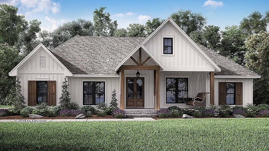 White bungalow farmhouse building plans with front porch and attic
