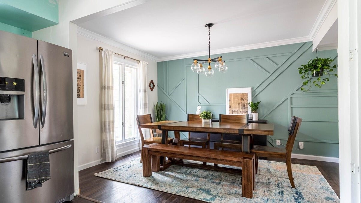 Dining room accent wall matches painted wall in open kitchen