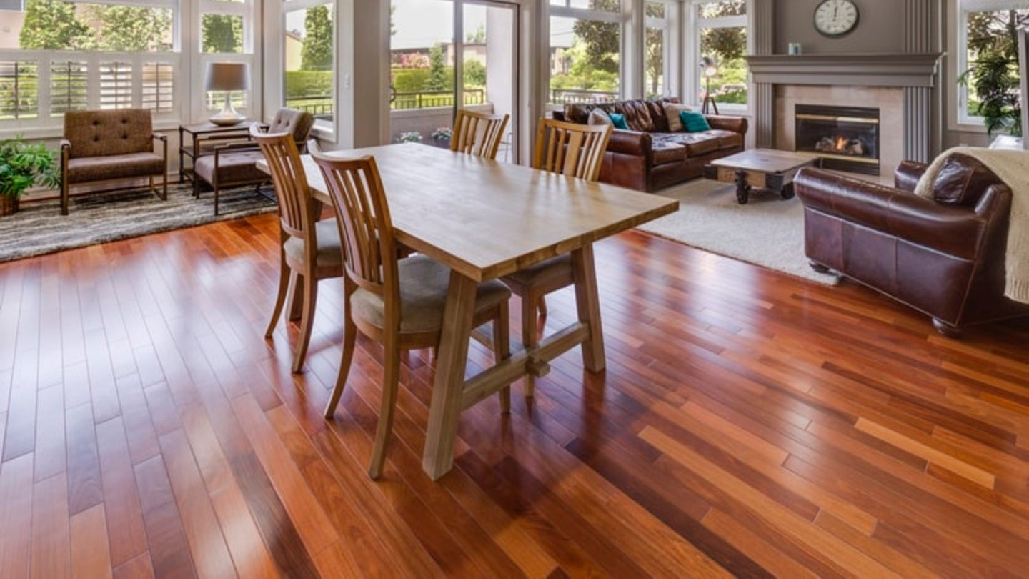Spacious and bright living room with beautiful hardwood floors.
