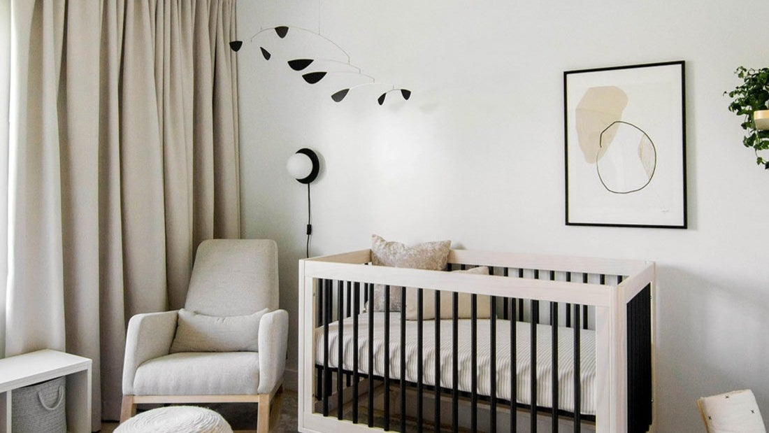 A black-and-white themed baby nursery.