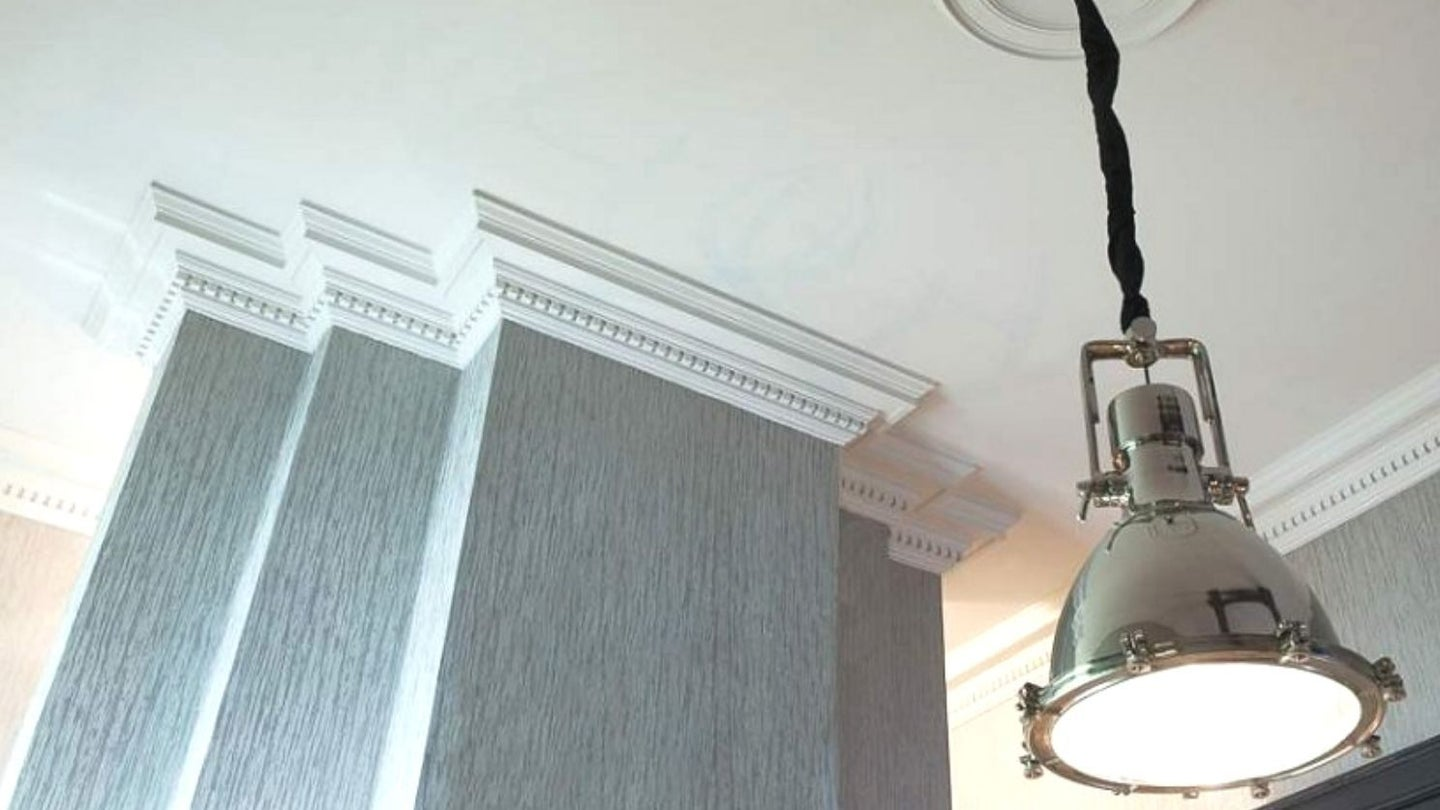 three connected columns joined to the ceiling with elaborate crown molding