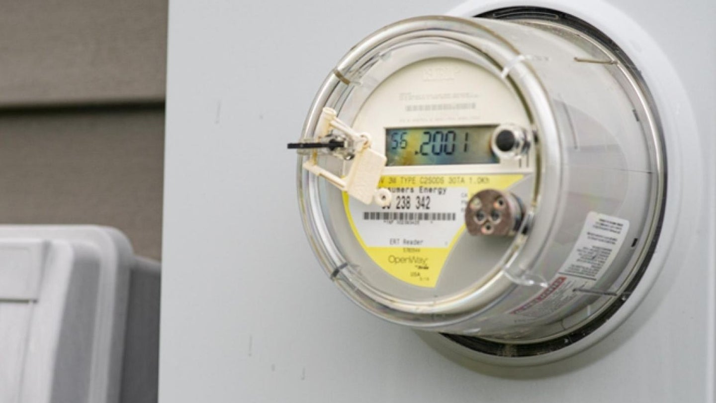 a smart electric meter with a digital display reading on the front