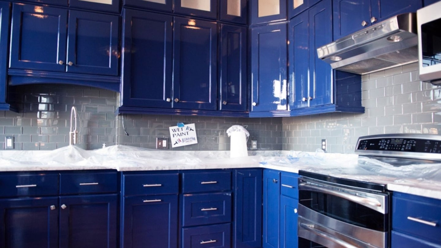 kitchen cabinets freshly painted in blue with a glossy finish