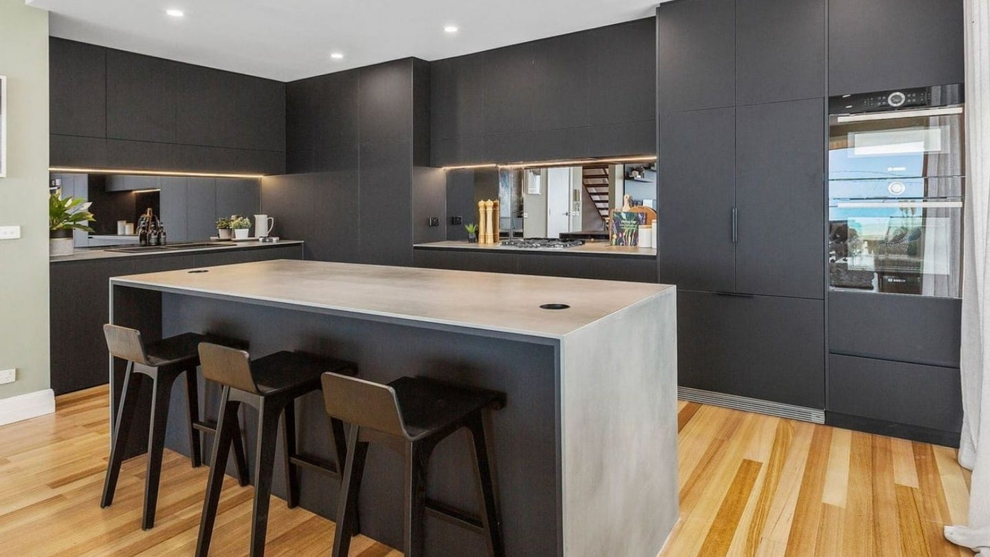 a kitchen with a matte finish paint job in black
