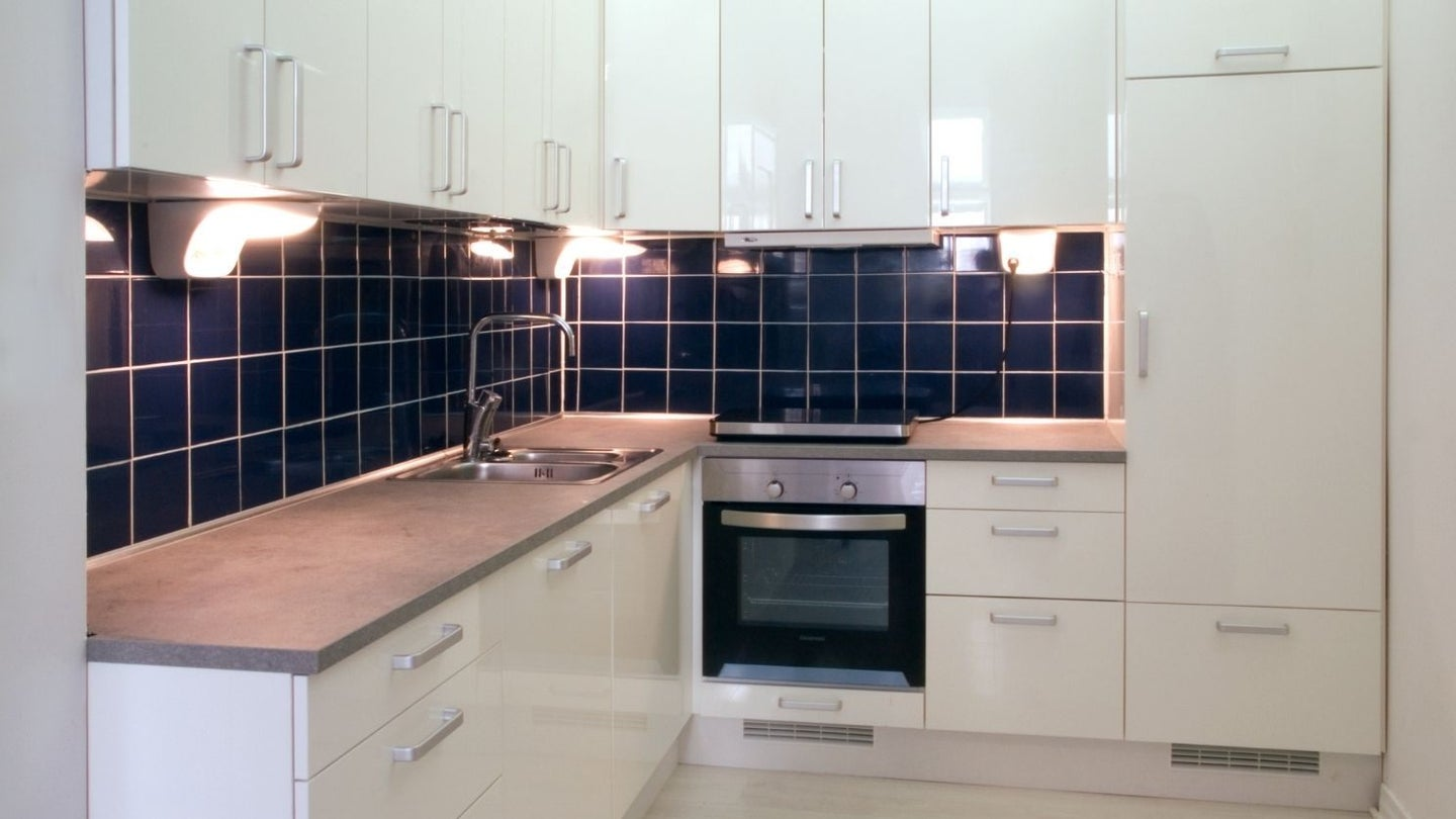a off white kitchen with high gloss paint sheen