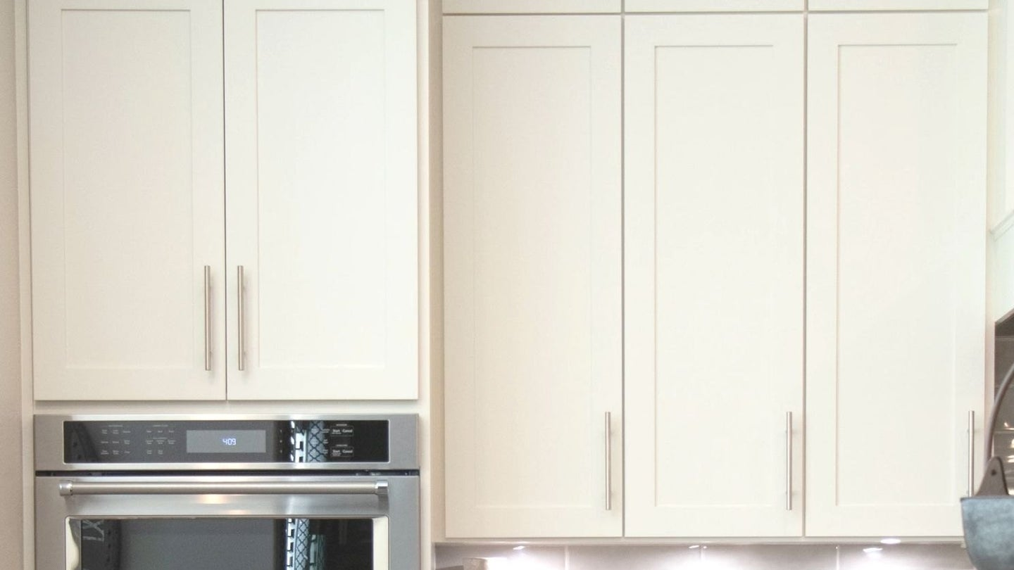 a row of kitchen cabinets with a self leveling paint job