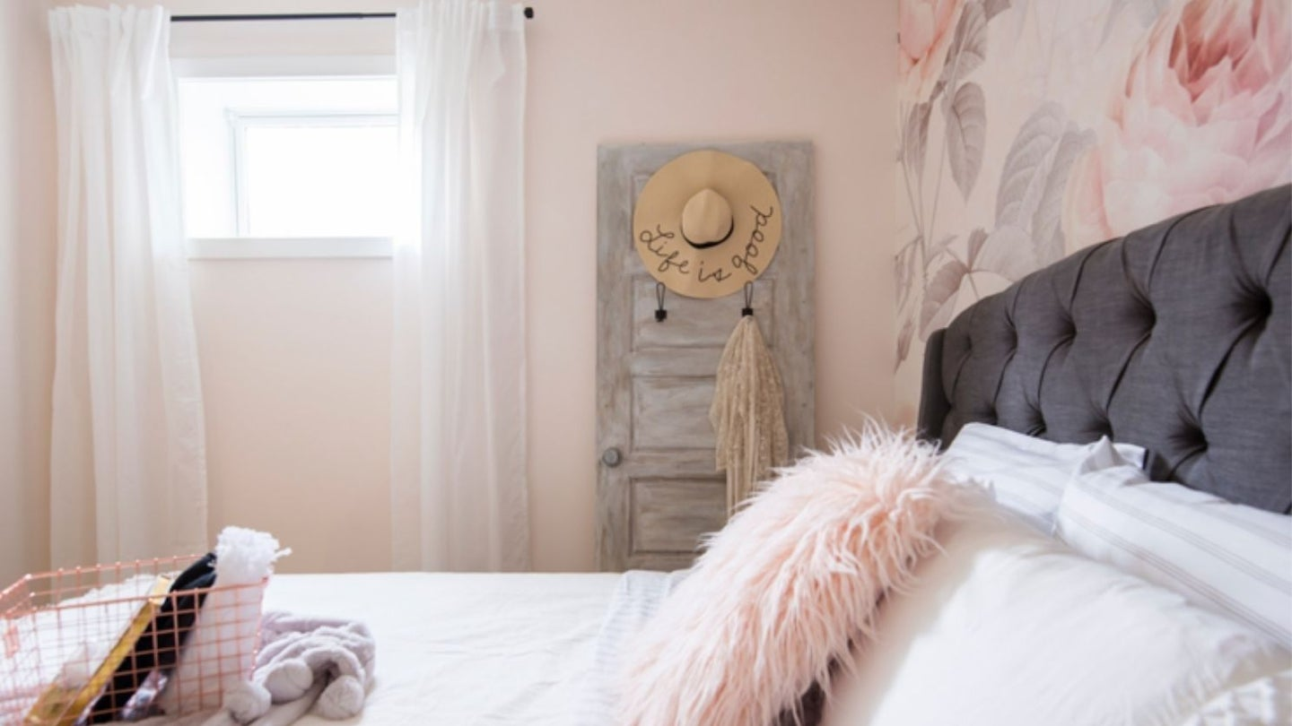 a shabby chic bedroom with shabby chic decorations, an old wood door, and floral pattern