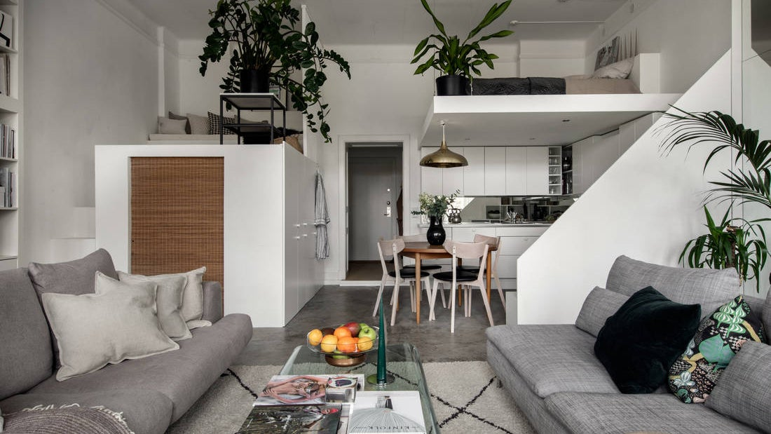 Modern apartment with two loft beds.