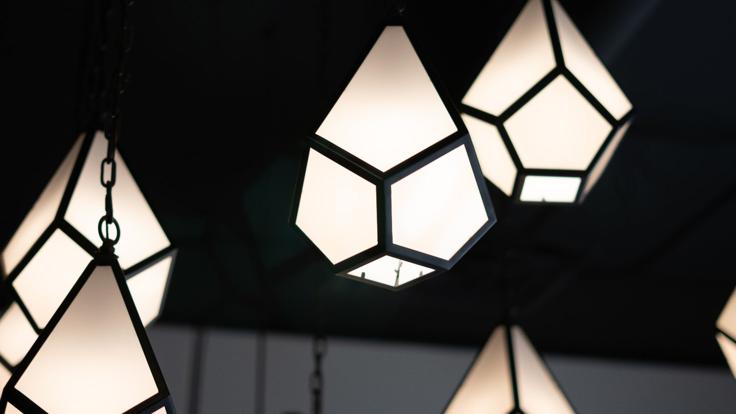 Geometric pendant lights hanging inside a room.