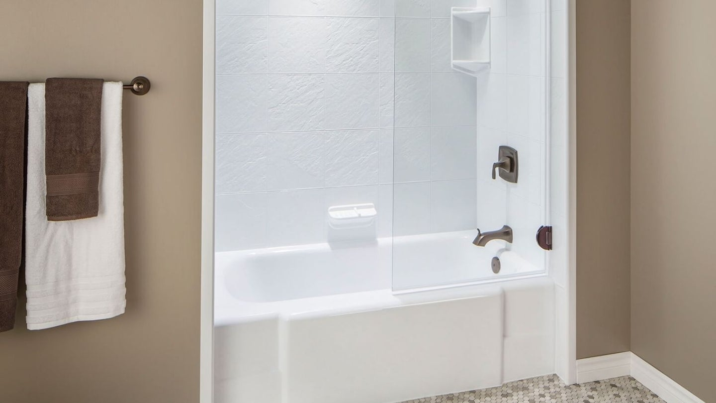 a white bathtub liner with a faucet fixture against brown walls