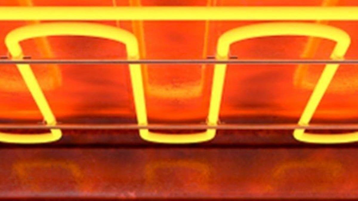 red glowing heating element curled inside a toaster oven