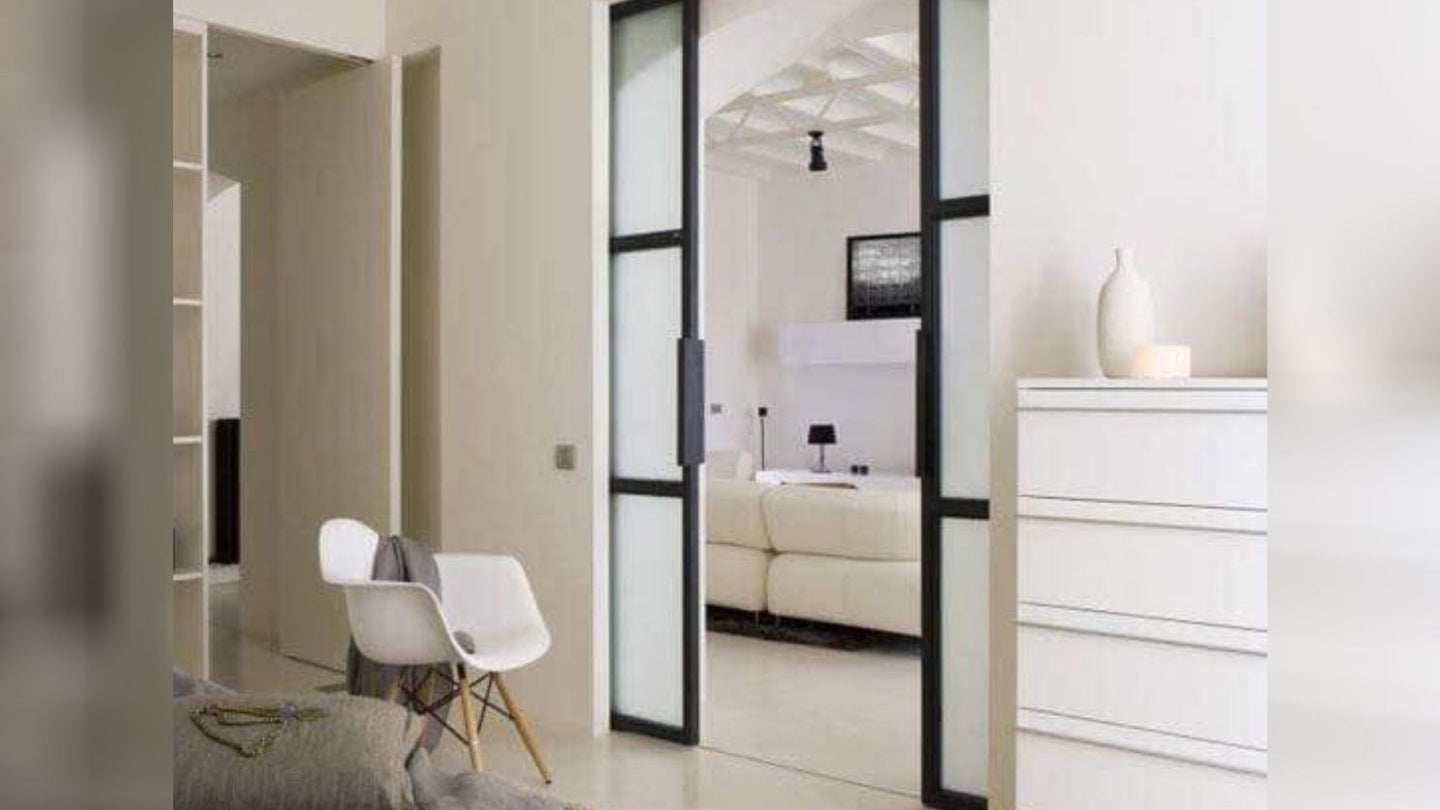 two sliding pocket doors separating a bedroom from a living room