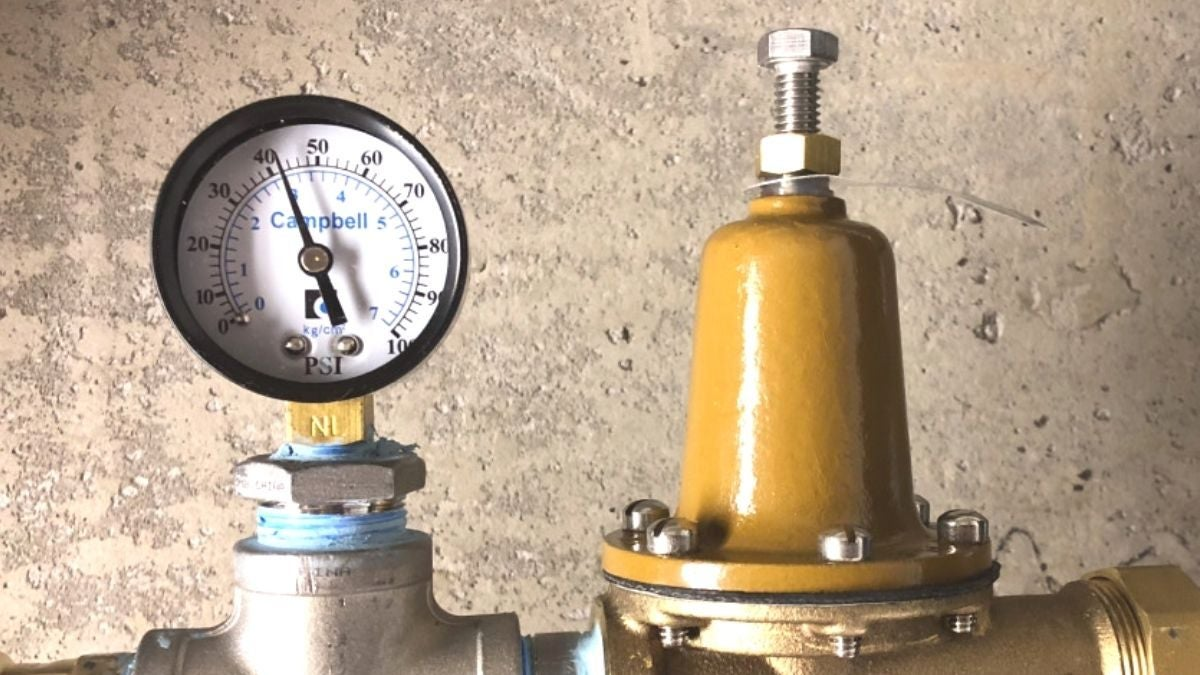 a water pressure regulator with a pressure gauge connected to a water line