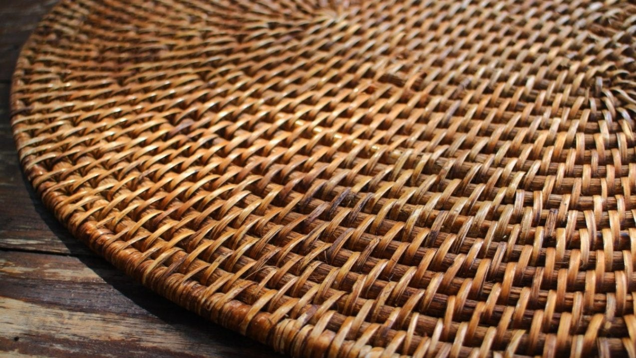 a rattan wicker rug on a wooden floor
